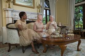 Aristocratic elderly ladies drinking afternoon tea in a wealthy home.